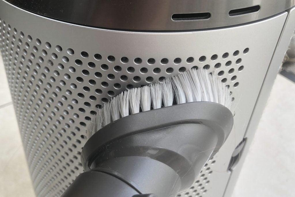 Vacuuming a Dyson fan's body